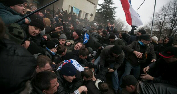 Crimean flag is seen during clashes by ethnic Russians and Tatars