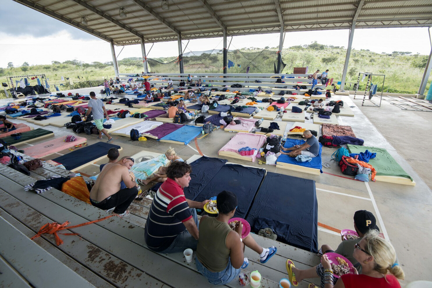 Cuban migrants rest in a shelter in La Cruz, Costa Rica