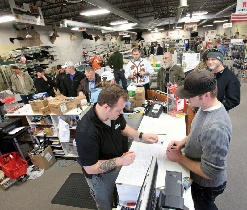 Customers stand in line to purchase weapons and accessories