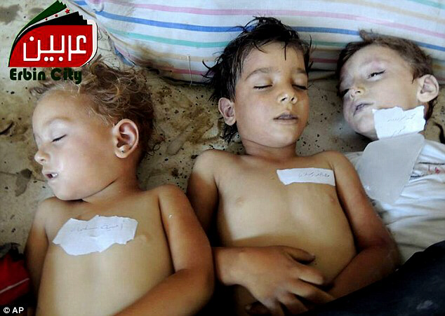 Innocent: Dead bodies of Syrian children after an alleged poisonous gas rocket attack fired by regime forces