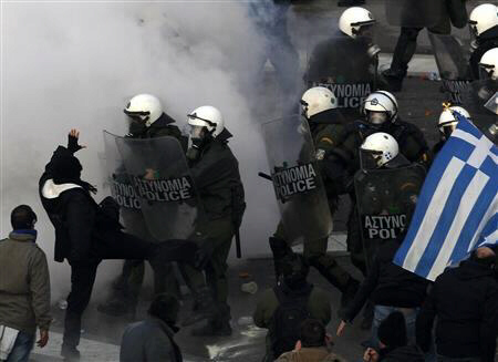 Demonstrators clash with riot police in Athens