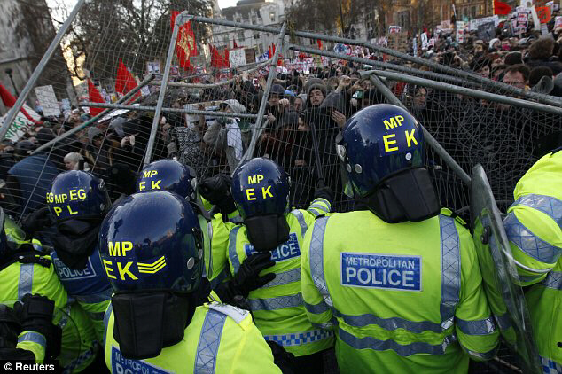Demonstrators confronting police officers outside the Houses of Parliament