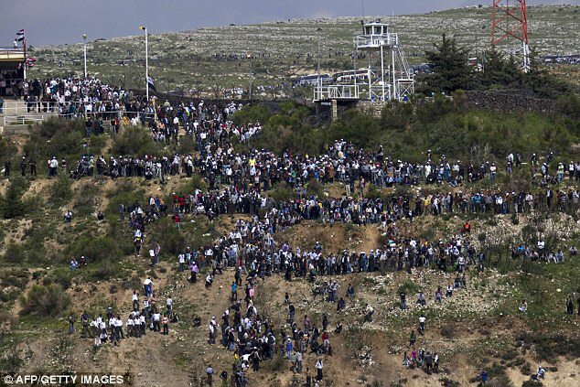 Demonstrators cross from Syria into the annexed Golan Heights