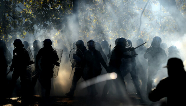 Demonstrators fight riot policemen during protest in Rome