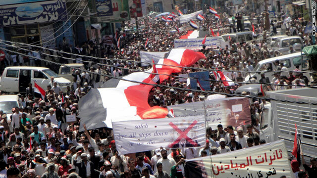 Demonstrators march in Yemen's Ibb province, about 120 miles from the capital, on Sunday, calling for the president to resign
