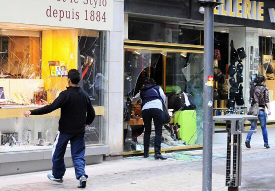 Demonstrators smash shop windows during riots in downtown Lyon