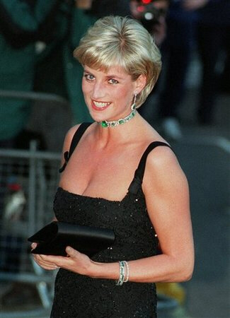 (AP) Diana, Princess of Wales, smiles as she arrives at the Tate Gallery in London in this Tuesday, July 1, 1997.