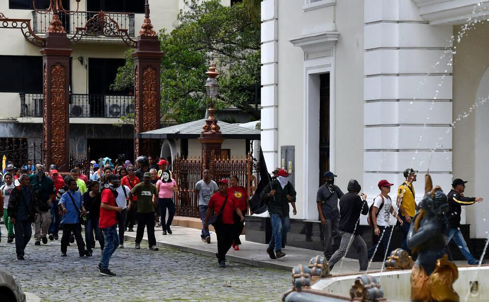 Dozens of pro-government activists stormed Venezuela's National Assembly