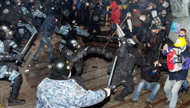 Dozens of protesters were wounded in a clash with police in Kiev