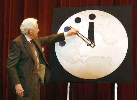 Dr Leon M Lederman moves the hands of the Doomsday Clock to 11:53 PM