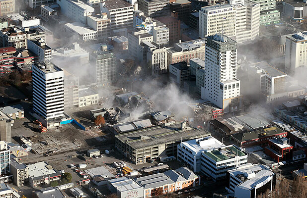 Dust rises from Christchurch's shattered central business district