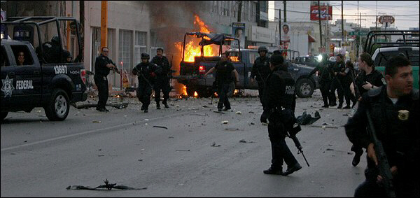 Federal police respond to an attack Thursday on the main avenue of Ciudad Juarez, Mexico, across the border from El Paso. (Jesus Alcazar/agence France-presse Via Getty Images)
