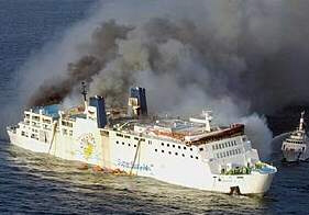 Thick smoke pours out of sinking ferry