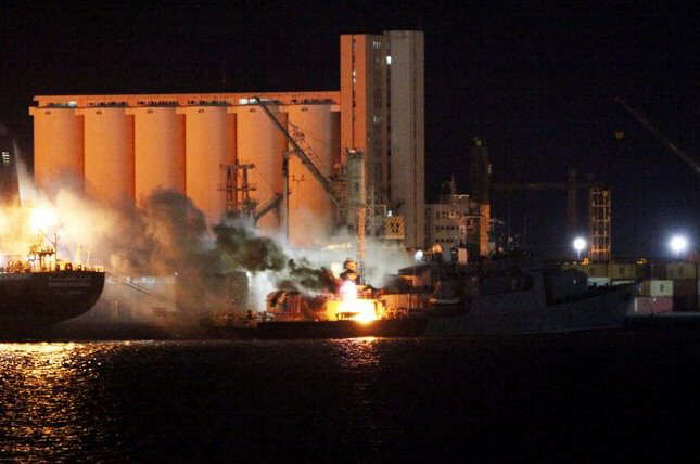Fire aboard boat in port of Tripoli hit by NATO airstrikes