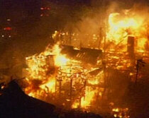 Flames engulf a home in Malibu, California