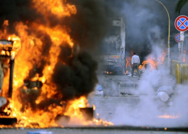 Flames engulf garbage trucks in Terzigno, Naples. People, demonstrating against plans to build a garbage dump near Naples, hurled stones and firecrackers at police and set vehicles ablaze on Thursday, and police said about 20 officers were injured. The clashes highlighted the latest garbage crisis in the area around Naples, southern Italy. Two years ago Premier Silvio Berlusconi intervened to resolve an emergency caused when collectors stopped picking up trash because dumps were full and residents protested new ones. Photo: AP October 22 2010 at 14:16