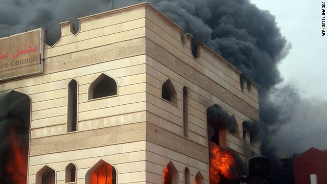Flames engulf the Wasit council building in Kut, where over 1,000 Iraqis demanded the provincial governor's resignation.