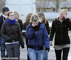 German girls cry after shootings that claim the lives of 11 fellow female students and 3 female teachers