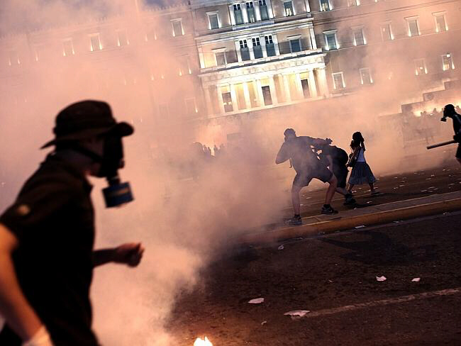 July 16, 2015: Greek protester clashes with riot police in Athens