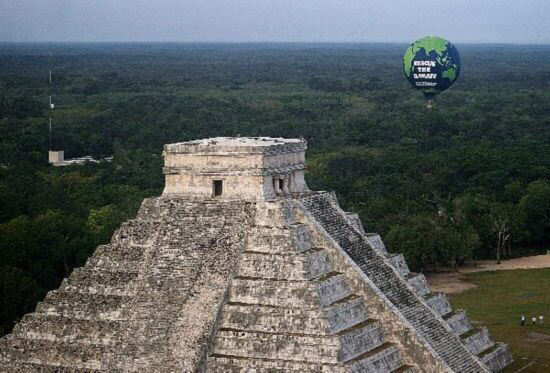 Greenpeace giant balloon rises next to Chichen-Itza pyramids in Mexico