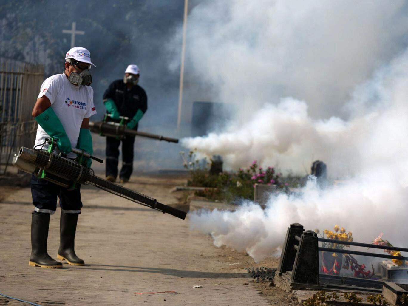 Health workers fumigating to combat Zika virus in Peru
