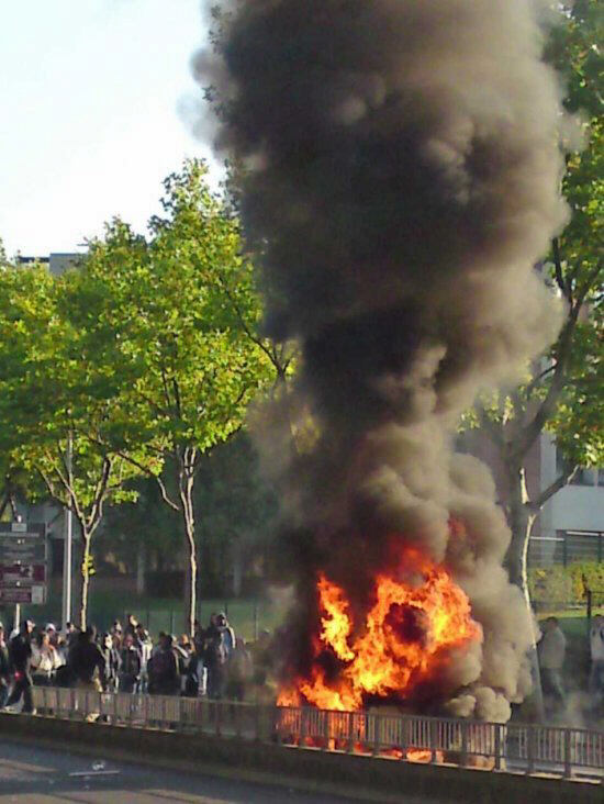 High school students demonstrate near Jolie Curie school in Nanterre, a Paris suburb, France, 18 October 2010. A car and some trash bins were burnt. A number of workers and students demonstrations were in progress at several french cities as part of the protest against the government pension law. EPA/MAXPPP/FLORENCE HUBIN FRANCE OUT, BELGIUM OUT