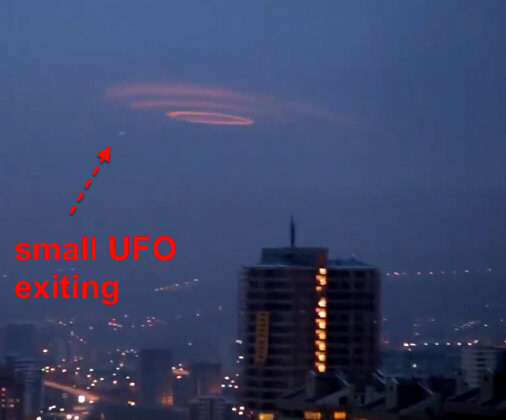 "Huge ""wormhole"" UFO with smaller UFO shooting out of it or past it"