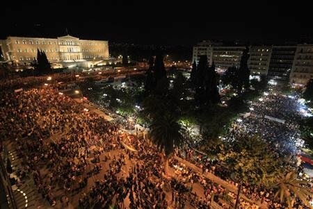 Huge crowd of protesters stands in front of Greek parliament during rally against austerity economic measures and corruption in Athens' Constitution square