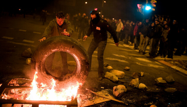 In Barcelona, demonstrators set up a barricade of burning tires