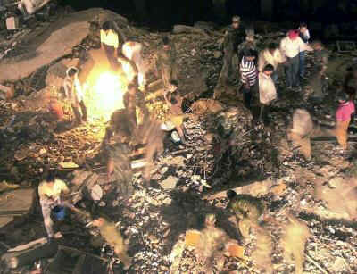 Firefighters, aid workers, Indian army search rubble for victims