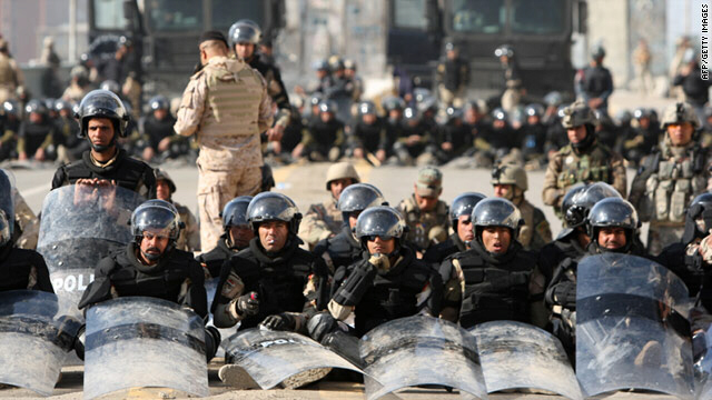 Iraqi riot police blocked the streets in the capital Baghdad on Friday as protesters headed on foot into the city center.