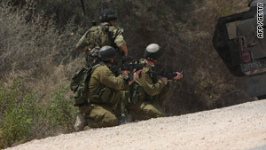 Israeli troops along the border between Israel and Lebanon