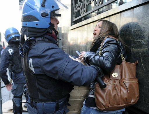 Italian riot police rough up and rape female protester