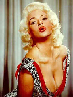 Jayne Mansfield blows a parting kiss