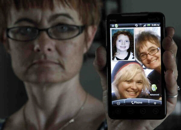 Karen Emery holds a cellphone showing the last photo she and her daughter, Allison Edwards, had taken together, on Thanksgiving 2010. Edwards was killed in Juniata Park on Dec. 3 of that year. (ELIZABETH ROBERTSON / Staff Photographer)