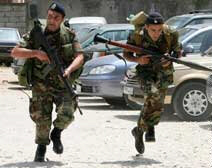 Lebanese soldiers run to take up positions during clashes