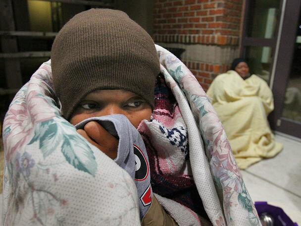 Lecher Eady (left) the mother of 16-month old triplets waited since midnight in the cold for hopes of getting financial assistance Thursday Dec.2, 2010 at the Mansour Center in Marietta. The single mother who has held 3 different jobs in 2010 is laid off from health care work.