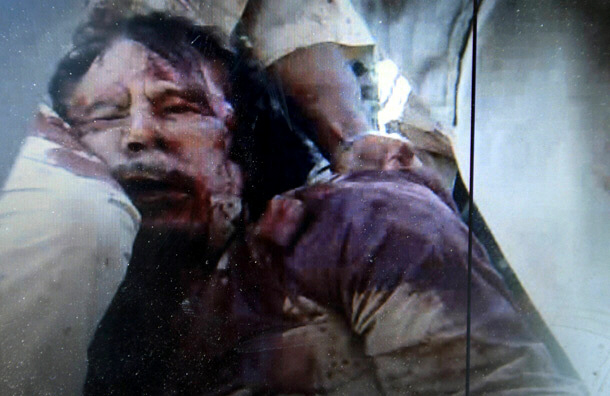 Libyan tyrant Moammar Gadhafi's bloodied corpse was paraded for millions to see on TV