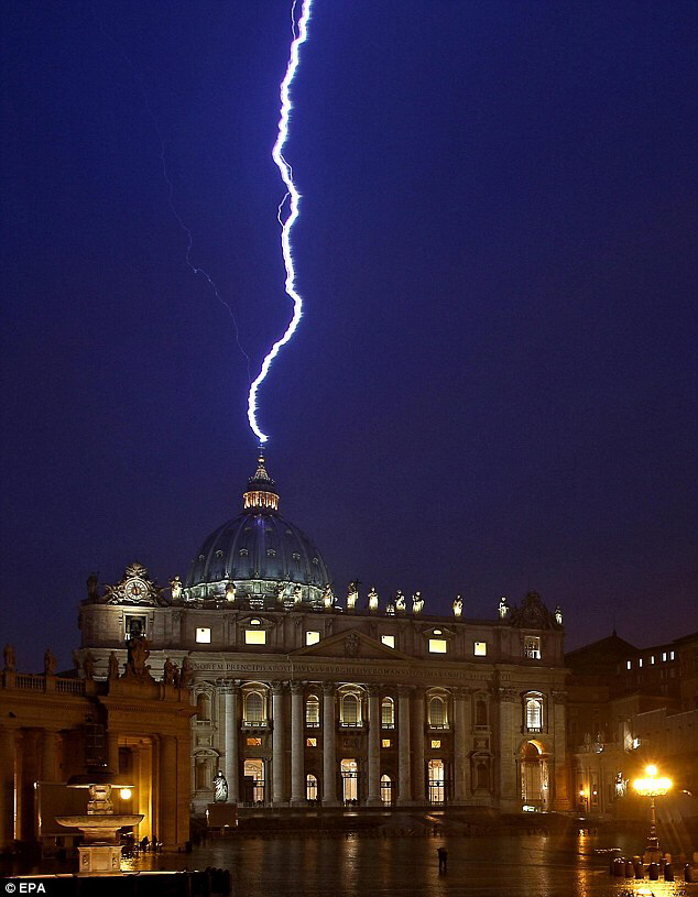 Lighting strikes the basilica of St.Peter's dome on February 11 only hours after the Pope announced his decision to resign on February 28