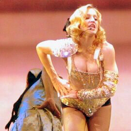 Madonna performs scantily clad with Kabbalah bracelets in 2005