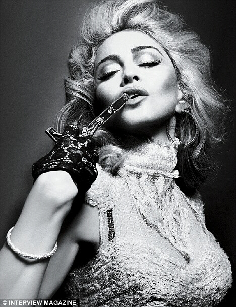 Madonna holds upsidedown crucifix to her pouting lip