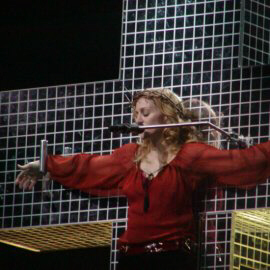Madonna on the cross, wearing a crown of thorns and scarlet blouse