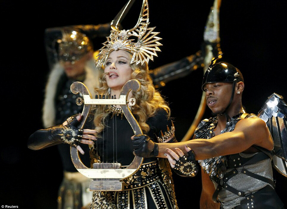 Madonna plays the lyre