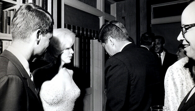 BOMBSHELL: Marilyn Monroe, at a gathering with Bobby and John Kennedy, JFK aide Arthur Schlesinger (far right, holding drink) and Harry Belafonte (in background, facing camera), starred in a porn flick in which she gave oral sex to a mystery man. The raunchy reel had then-FBI boss J. Edgar Hoover desperately trying to prove JFK was the man in the film.