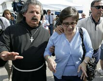 Mary Schindler, Terri Schiavo's mother, is escorted into the hospice where her daughter died