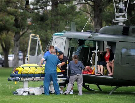 Medics help injured bystanders out of a helicopter
