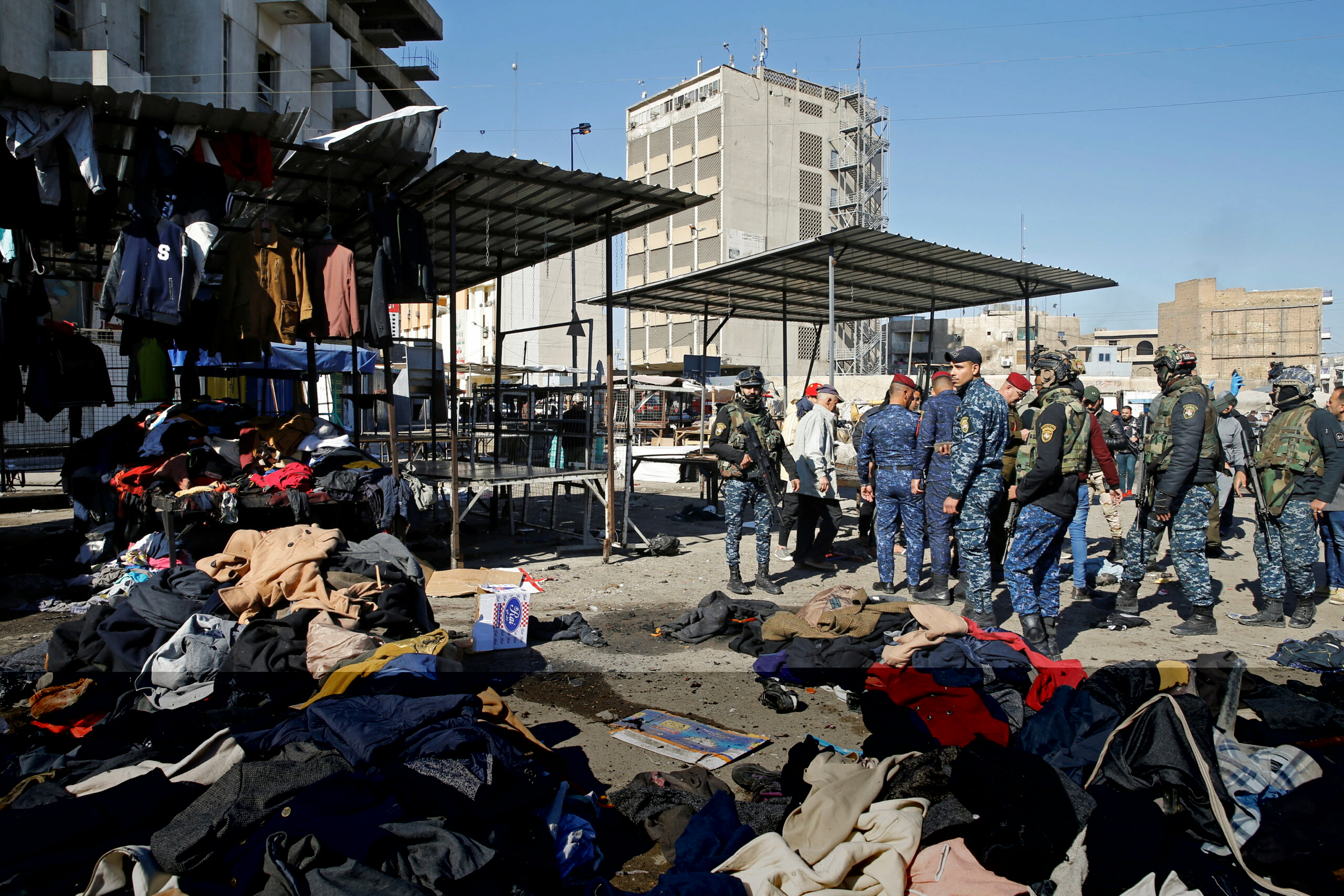 Members of Iraqi security forcers inspect site of suicide attack in Baghdad