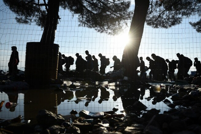Migrants walk from northern Greek village Idomeni into Macedonia