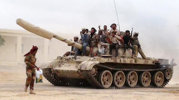 Militants loyal to President Abd Rabbuh Hadi move tank at al-Anad air base