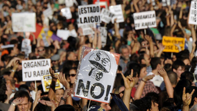 "More than 10,000 protesters retake the streets Saturday, in Madrid, where five months ago the ""May 15 Movement"" began. Some demonstrators said they felt Spain's protest had gone global and that the world had joined their movement."